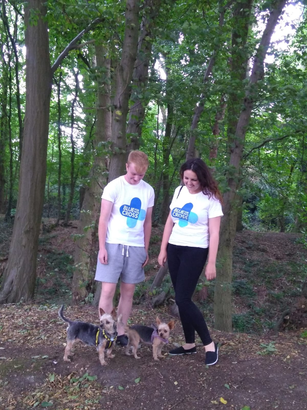 Lisa and Asher in Blue Cross T Shirts with two Yorkshire Terriers