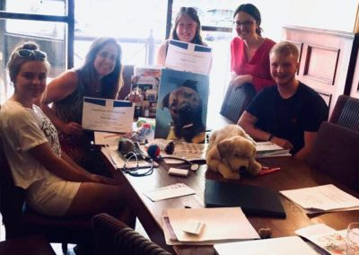 Millie, Kate, Angie, Lisa and Asher of Albany Pet Services taking a team photo during a pet care advice and team training meeting.