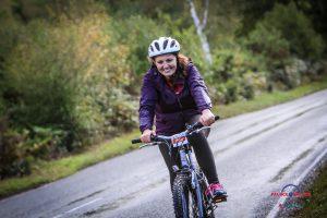 Lisa smiling on a bike