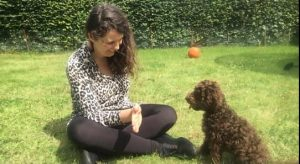 Lisa with a minature brown poodle